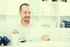 Positive young man in office Royalty Free Stock Photos