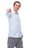 Positive young man pointing finger and smiling Royalty Free Stock Photography