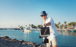 Positive young man take a selfie photo in tropical harbor Royalty Free Stock Photo
