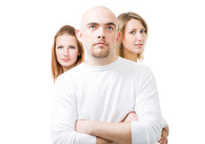 Positive young man with two women. In white,isolated Royalty Free Stock Photo