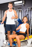 Positive young man and woman taking pause between exercising in Royalty Free Stock Photo