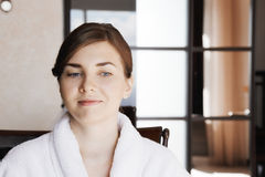 Positive young woman in bathrobe Royalty Free Stock Image