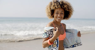 Positive Young Woman On The Beach Stock Image