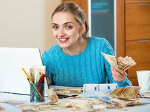 Positive young woman earning money being freelancer royalty free stock photos