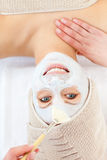 Positive young woman enjoying a beauty treatment Stock Image