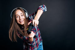 Positive young woman holding game console Royalty Free Stock Photography