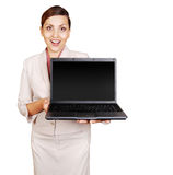 Positive young woman with laptop in hand Stock Photography