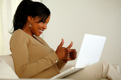 Positive young woman looking to laptop screen Stock Photos