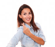 Positive young woman with lucky sign Stock Image