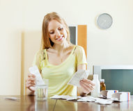 Positive young woman with medications Stock Images