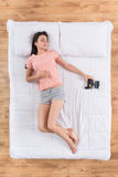 Positive young woman sleeping on bed Royalty Free Stock Images