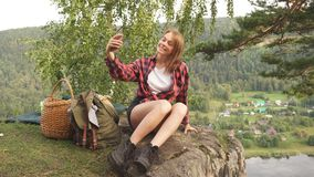 Positive young woman taking selfie outdoors. stock video footage