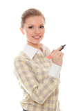 Positive young woman writes something marker Royalty Free Stock Photography