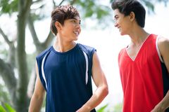 Positive youngsters. Two boys in sports clothing talking outdoors Royalty Free Stock Photos