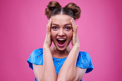 Positively astonished female with hands on the head Royalty Free Stock Photo