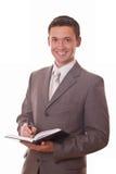 Positiver Geschäftsmann mit Notizblock Lizenzfreies Stockfoto