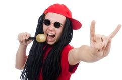 Positiver Junge mit dem Mikrofon lokalisiert auf dem Weiß Lizenzfreie Stockfotografie
