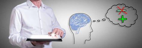 Positives Gedankenkonzept mit dem Mann, der eine Tablette verwendet Stockfotografie