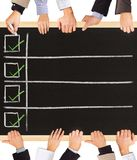Positives. Photo of business hands holding blackboard and writing Positive symbols Stock Images