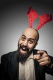 Positives Weihnachtsbärtiger Mann Stockfoto