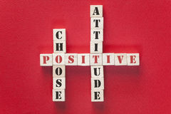 Positivity concept. With motivational words written on wooden blocks stock photography