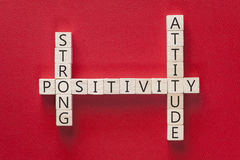 Positivity concept. With motivational words written on wooden blocks stock photo
