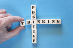 Positivity concept. With motivational words written on wooden blocks stock images