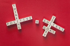 Positivity concept. With motivational words written on wooden blocks stock image