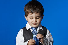Positivity, cute little boy portrait over blue chroma background Stock Photography
