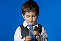 Positivity, cute little boy portrait over blue chroma background. Tie, cute little boy portrait over blue chroma Stock Photography