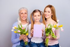 Positivity event maternity relatives motherhood freshness concept. Portrait of charming mum sweet school girl cheerful dreamy gr. Anny demonstrating violet card royalty free stock photo