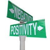 Positivity vs Negativity - Two-Way Street Sign. A green two-way street sign pointing to Positivity vs Negativity Stock Images