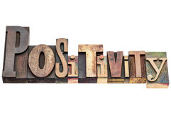 Positivity word typography in letterpress wood type Stock Image