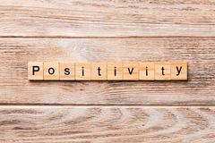 Positivity word written on wood block. positivity text on wooden table for your desing, concept stock photo