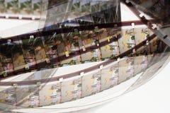 Positivo velho tira do filme de 16 milímetros no fundo branco Fotos de Stock