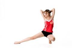 Posizione accoccolata della ragazza & esercitazione dello strech Fotografia Stock
