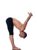 Posizione d'allungamento relativa alla ginnastica dell'uomo Fotografia Stock