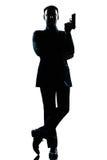 Posizione del James Bond dell'agente segreto dell'uomo della siluetta Fotografia Stock Libera da Diritti
