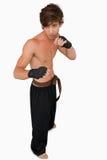 Posizione di lotta intestina del combattente di arti marziali Fotografie Stock Libere da Diritti
