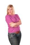 Posizione di mezza età dei basamenti della donna Fotografie Stock