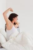 Posizione femminile del brunette Charming mentre allungando Fotografia Stock Libera da Diritti