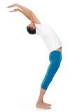 Posizioni di pratica di yoga del giovane Immagine Stock