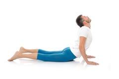 Posizioni di pratica di yoga del giovane Fotografie Stock Libere da Diritti