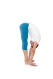 Posizioni di pratica di yoga del giovane Immagine Stock Libera da Diritti