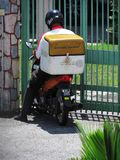 PosLaju Dispatch Rider. Delivery man from Malaysia`s National Courier PosLaju, a subsidiary of Pos Malaysia Bhd, out on delivery on a motorbike Stock Photography