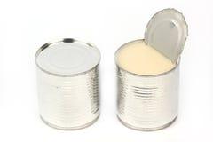 Possa do leite condensado abrandado imagens de stock