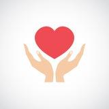 A posse da mão protege o coração Fotografia de Stock