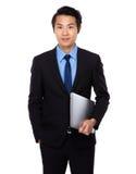 Posse do homem de negócios com laptop Imagem de Stock