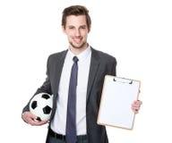 Posse do sofá do futebol com bola de futebol e prancheta imagens de stock