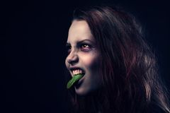 Possessed girl with her ��tongue out Royalty Free Stock Photo